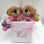 Teddies on a box